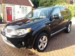 black mitsubishi outlander mitsubishi outlander warrior di d 2009 2 0l 7 seats 4x4 black mot