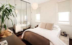 awesome small bedroom with large mirror and window blinds also