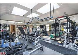 celebrity home gyms rumor confirmed dr dre buys tom and gisele s estate