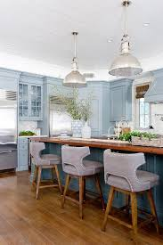 light grey kitchen cabinets with wood countertops blue center island with wood countertop transitional kitchen