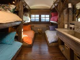 Cabin Kids Room Features Builtin Treehouse Bunk Beds Dressed In - Treehouse bunk beds