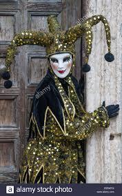 venetian jester costume jester or clown in black gold costume in front of san zaccaria