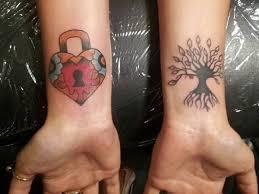 27 affectionate heart locket tattoo ideas