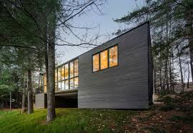 modern prefab cabin in quebec uses innovative wood panels