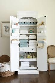 linen cabinet with tilt out hamper best home furniture decoration
