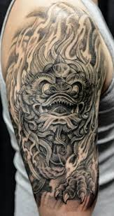 grey ink foo dog half sleeve tattoo