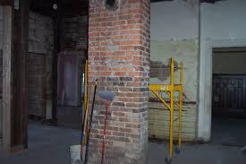 kitchen design details and original brick fireplace in center of