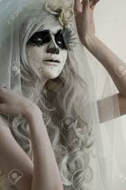 halloween witch beautiful woman wearing santa muerte mask and