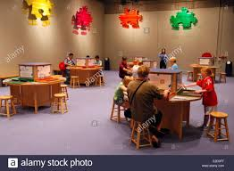 china hong kong kowloon science museum visitors sitting making