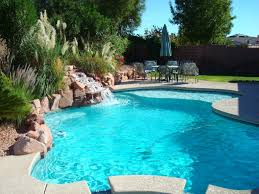 Backyard Pool With Slide Exterior Swimming Pool With Grey Curved Slide And Rock Waterfall