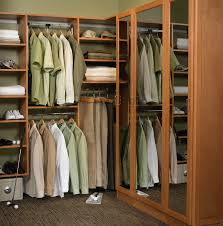 brown wooden closet on brown rug having brown wooden shelves and