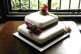 2 tier wedding cake with fresh flowers tier square wedding cake