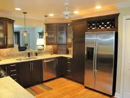 river white granite with dark cabinets white river granite dark cabinets light hardwood flooring