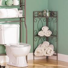 Bathroom Corner Shelf Ideas by Short Metal Corner Shelves Next To Two Pieces Toilet In Bathroom