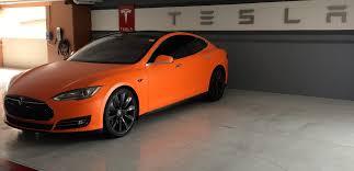 tesla model s wrapped in matte orange teslamotors