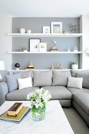 Gray Sofa Living Room Inside A Canadian Condo With Scandinavian Style White Shelves