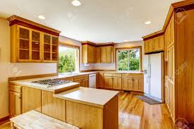 brown kitchen cabinets to white light brown kitchen cabinets white appliances and hardwood floor