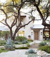Modern Front Yard Desert Landscaping With Palm Tree And Home Tour Tasteful And Timeless In Austin Mid Century Modern