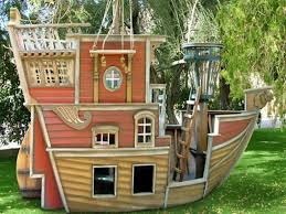 cool playhouses from wood with pirate ship shape ideas in garden