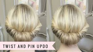 twist and twist and pin updo by sweethearts hair