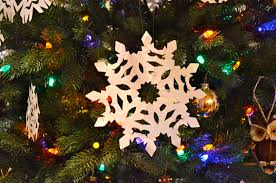 around the blocks christmas bokeh and paper snowflakes
