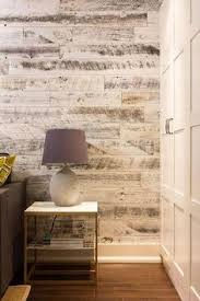 laminate flooring on walls for a warm and luxurious feel of the