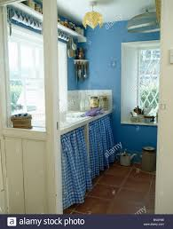 Cottage Kitchen Curtains by Blue Checked Curtains On Cupboard Below Sink In Blue Cottage