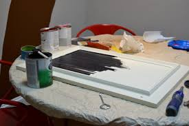 How To Paint Cabinet Doors How To Turn A Cabinet Door Into A Memo Board The Diy Bungalow