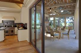 enclosed patio kitchen rustic with wood floors custom hood white