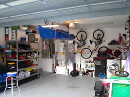 a kayak hoist is a beneficial multi purpose item for organizing
