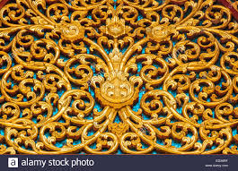 thai style golden wall ornaments stock photo royalty free image