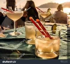 holiday cocktails background margarita cocktail glasses on beach bar stock photo 517964683