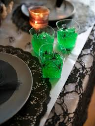 halloween party ideas make green gelatin shots with spiders diy