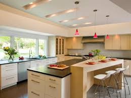 light filled contemporary kitchen feinmann inc design build hgtv neutral contemporary kitchen with large island and red pendant lighting
