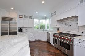 corner apron sink under wraparound windows transitional kitchen