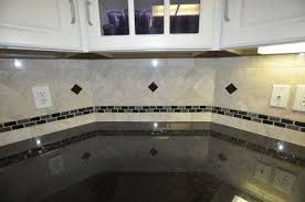 ceramic tile backsplash with white wood cabinet in the wall