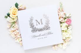 monogrammed wedding guest book dusty blue and white monogram wedding guest book blush paper co