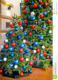 White Christmas Tree With Blue Decorations Red Blue And White Decorating Balls On The Christmas Tree At Th