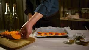 A Chef Slicing A Pumpkin by Raw Pumpkin Pieces Close Up Pumpkin Slices On Wooden Board