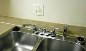 gfci distance from sink how far apart should kitchen counter receptacles be spaced