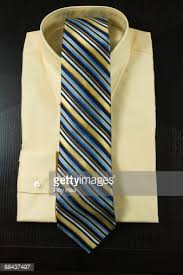 stack of mens dress shirts with tie stock photo getty images