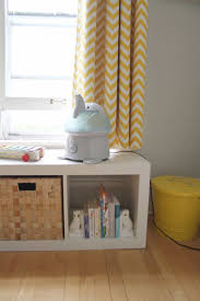 baby nursery with chevron curtains and elephant humidifier