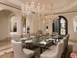 Dining Room Crystal Chandelier by Traditional Dining Room With Travertine Tile Floors U0026 Columns In