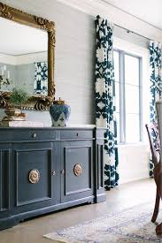 blue and gray dining room with blue sideboard cabinet