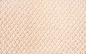 beige quilted pattern background stock photo image 47989211