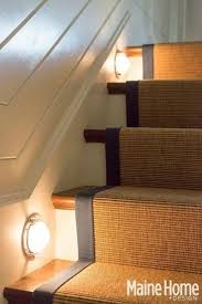 blue nautical decor in an elegant maine home stair lights a