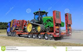tractor volvo volvo fh hauls john deere tractor editorial stock photo image