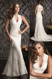 white mermaid wedding dress made of of lace and satin