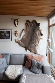 lodge interior of hunting room with exposed wood ceiling and
