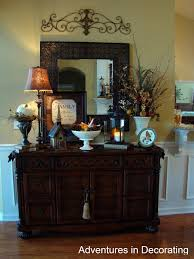 metal piece above mirror over buffet love this for the formal